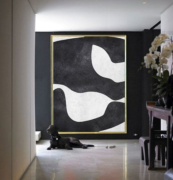 an oversized abstract wall art will make your entryway super chic and refined