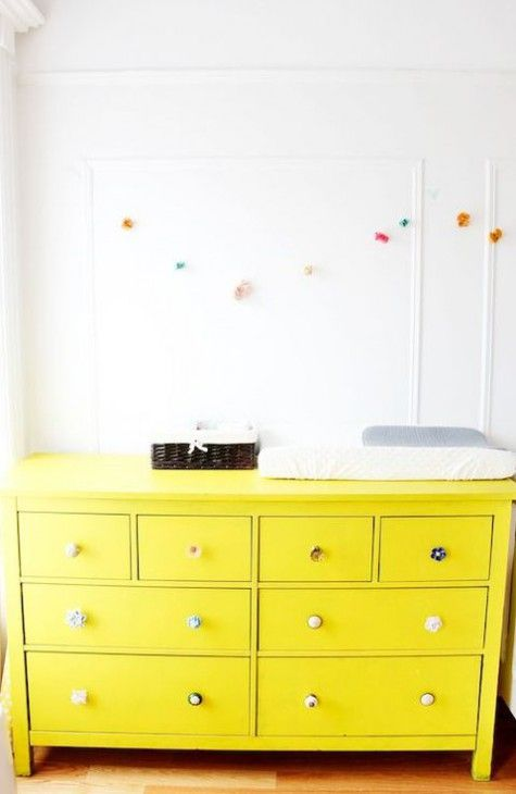 IKEA Hemnes hack in bold yellow with different knobs for a bold nursery