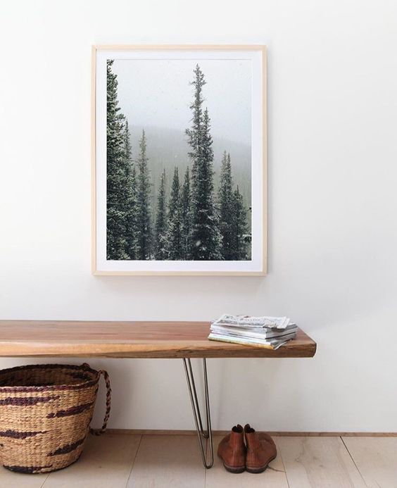 a beautiful artwork adds a natural feel to this entryway and catches an eye