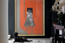 18 an oversized abstract artwork makes a bold stylish statement in this entry