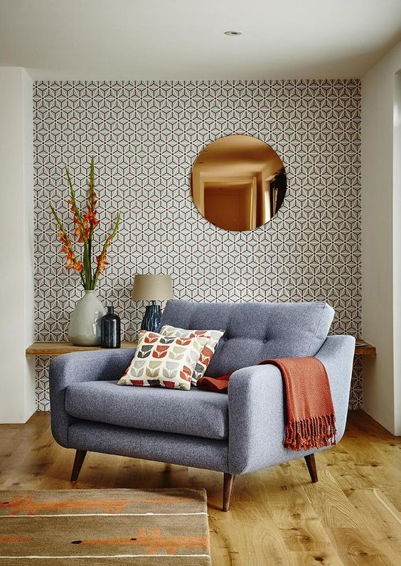 the mid-century modern style of the room is highlighted with this eye-catchy wallpaper wall