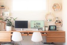 19 a custom-made floating desk for two and some floating shelves on each side