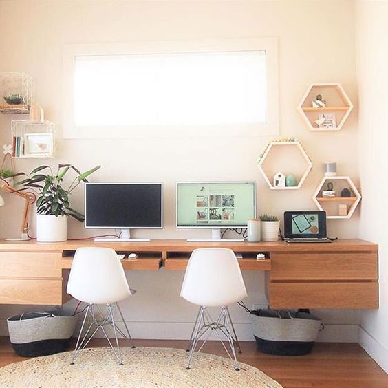 a custom-made floating desk for two and some floating shelves on each side