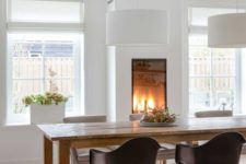 19 a gorgeous built-in fireplace in the dining room makes it cozy and highlights the space