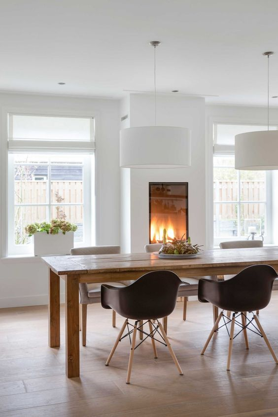 a gorgeous built-in fireplace in the dining room makes it cozy and highlights the space