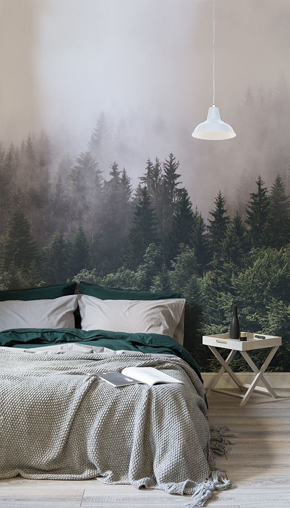 a realistic forest wall mural makes a statement in this space and looks relaxing