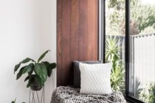 19 a windowsill covered with dark stained wood is a great seat or daybed