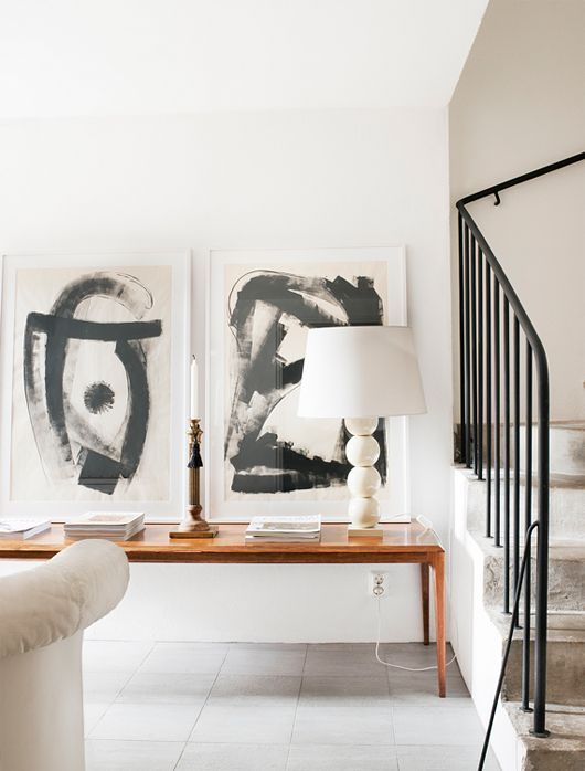 an abstract black and white artwork duo is a chic idea for a modern interior