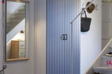 19 smokey blue wood doors with a texture and small black handles look cute and interesting