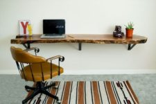 20 a floating desk of a wooden slab with a live edge will bring a natural touch