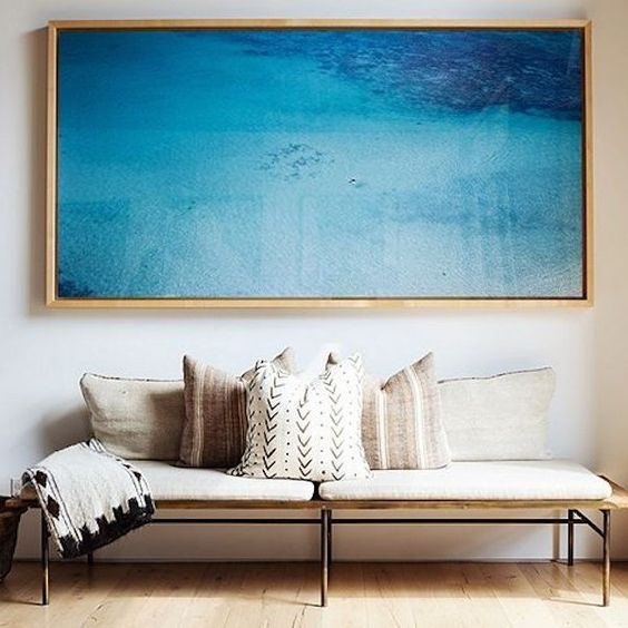 a sea artwork is always a win-win idea and will add a relaxing touch to the space