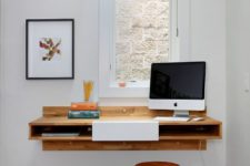 21 a floating mdi-century modern desk with storage space inside and a matching metal stool