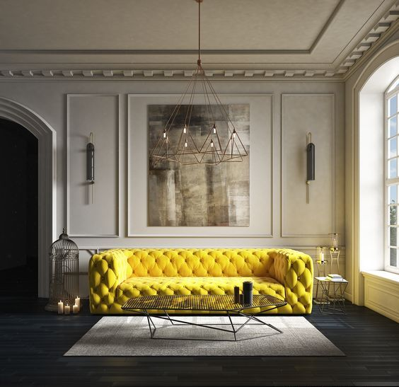 a super bold yellow tufted sofa makes a cool statement in a neutral space