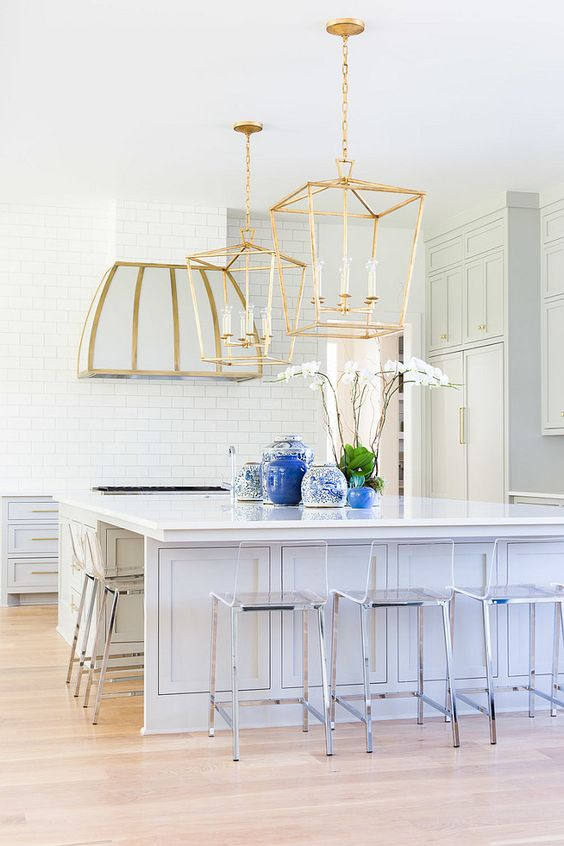 large brass pendant lamps and hood and stainless steel chairs