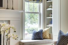 22 a small and comfy windowsill seat with upholstery and built-in shelves