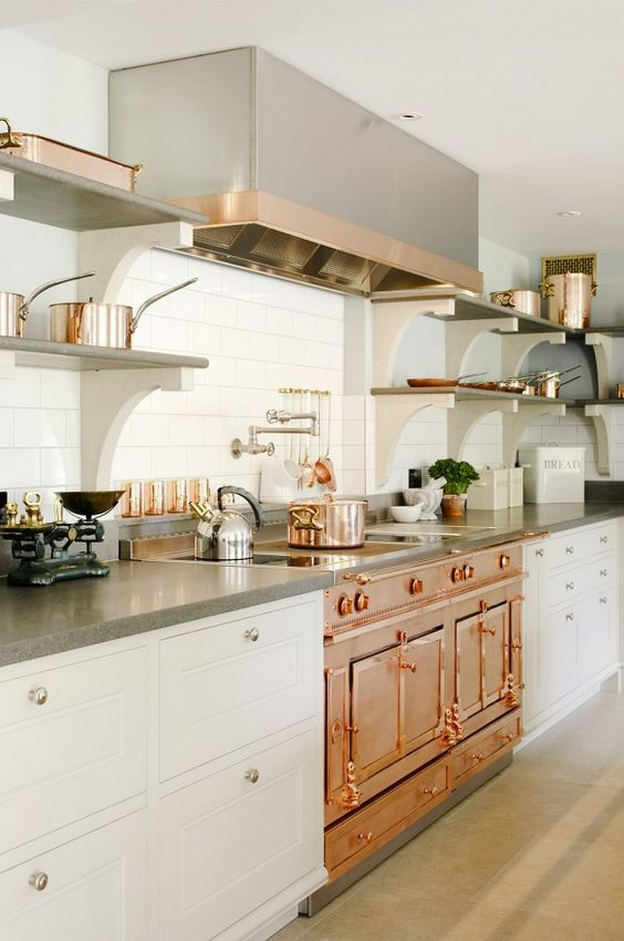 a vintage-inspired copper cooker and hood are the main pieces, and stainless steel touches look harmonious