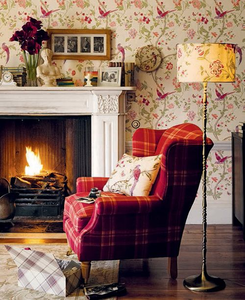 an English country living room with colorful flora and fauna print wallpaper to add to the style