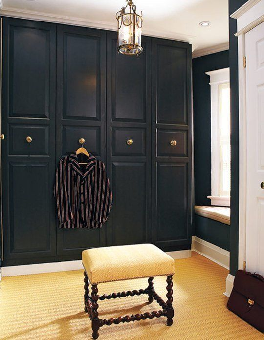 very elegant Pax hack with black paint, molding and vintage brass knobs is ideal for vintage spaces