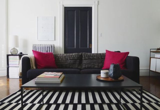 a Stockholm rug and sofa for a monochrome interior and a couple of fuchsia pillows for a colorful splash