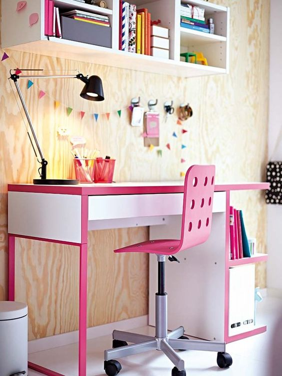a colorful IKEA Micke hack with pink touches for a little girl's workspace