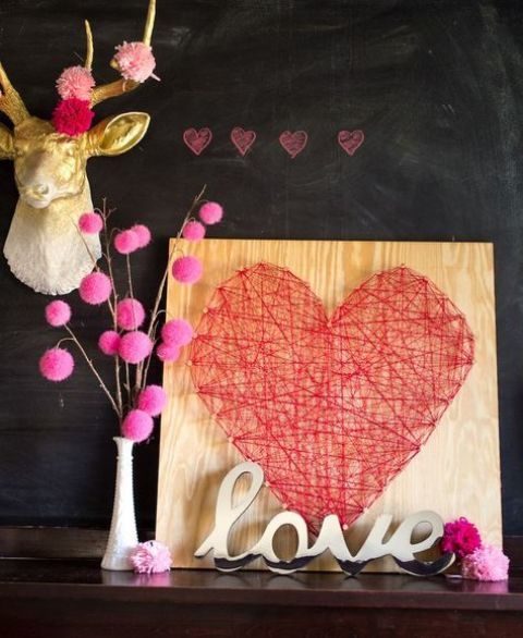 a string art red heart sign for a bold modern look