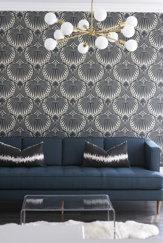 a stylish wallpaper accent wall for a mid-century modern styled room