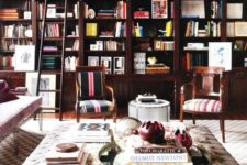 23 an oversized neutral upholstered ottoman and coffee table in a library