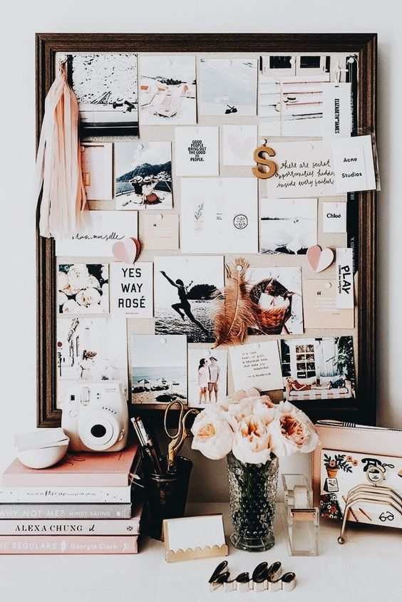 a fabric pinboard in a dark stained wooden frame looks chic and stylish