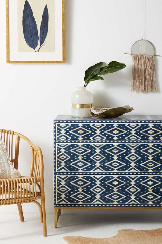 a patterned inlayed dresser is an amazing idea for a boho chic space