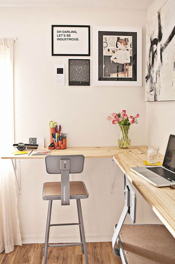 a shared wall-mounted work station with industrial chairs is a very comfy idea