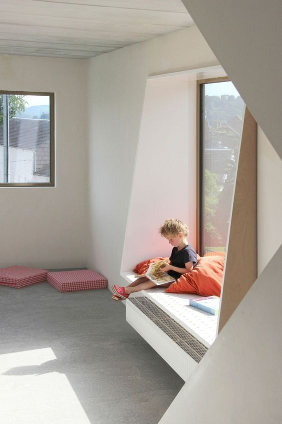 a windowsill with a comfy seat can be used as a reading space for a kid