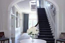 24 an oversized crystal ball chandelier to add a glam feel to your entry