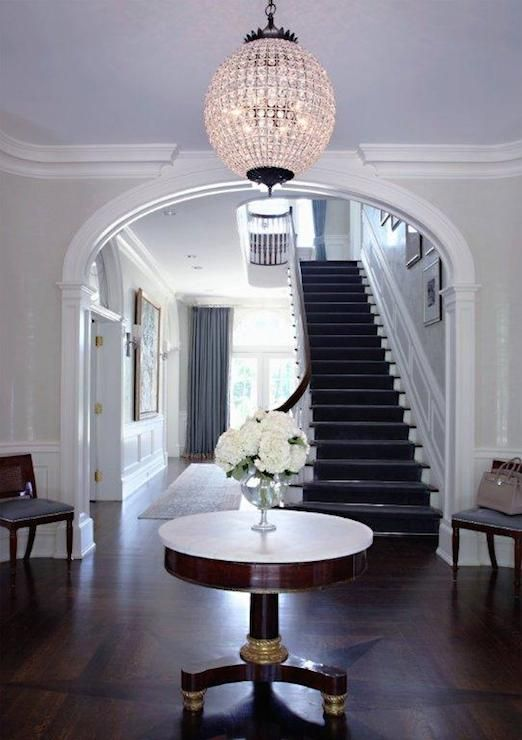 an oversized crystal ball chandelier to add a glam feel to your entry