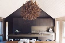 24 highlight the ceiling with a driftwood chandelier and a contrasting black wall