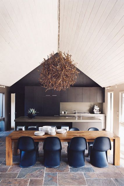 highlight the ceiling with a driftwood chandelier and a contrasting black wall