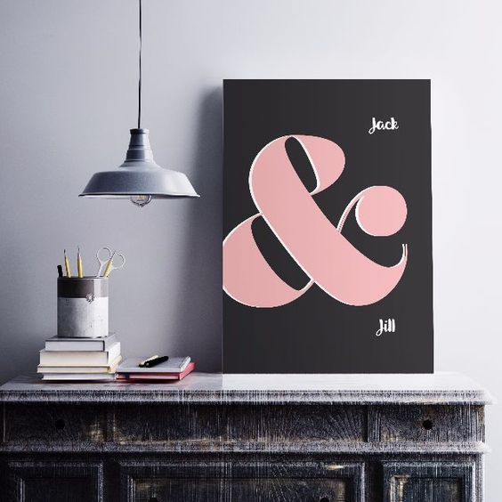 a stylish modern ampersand sign with a black backdrop and a large pink ampersand