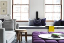 25 an oversized upholstered purple ottoman spruces up the neutral space and adds a touch of color