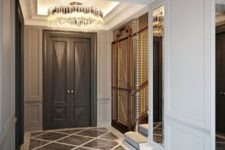 26 a couple of glam and super shiny crystal and metallic chandeliers for a refined modern space
