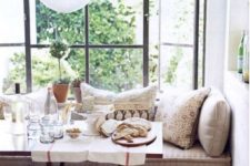 26 an upholstered windowsill bench with drawers is an ideal seat for any eating space