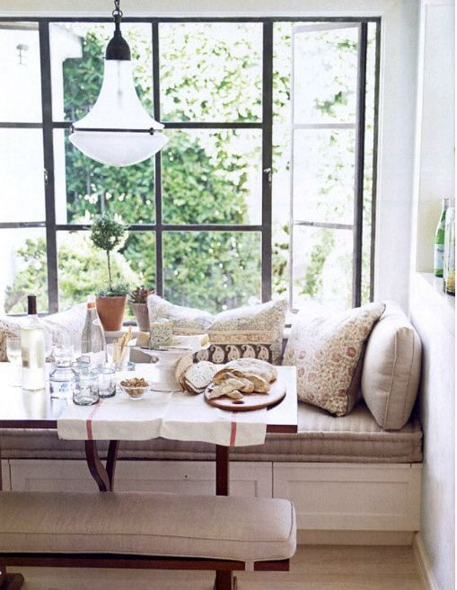 an upholstered windowsill bench with drawers is an ideal seat for any eating space