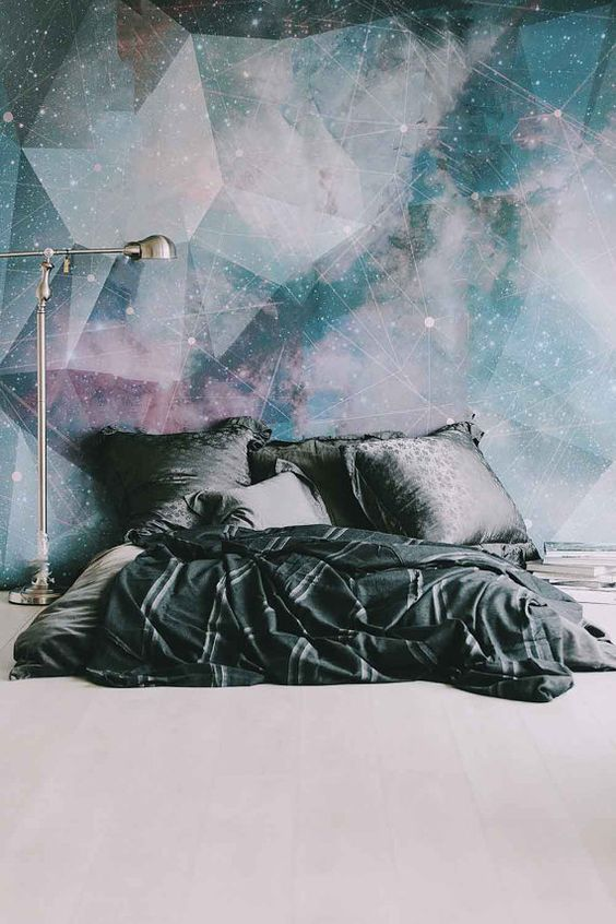 galaxy-inspired wall mural makes a bold statement in the space