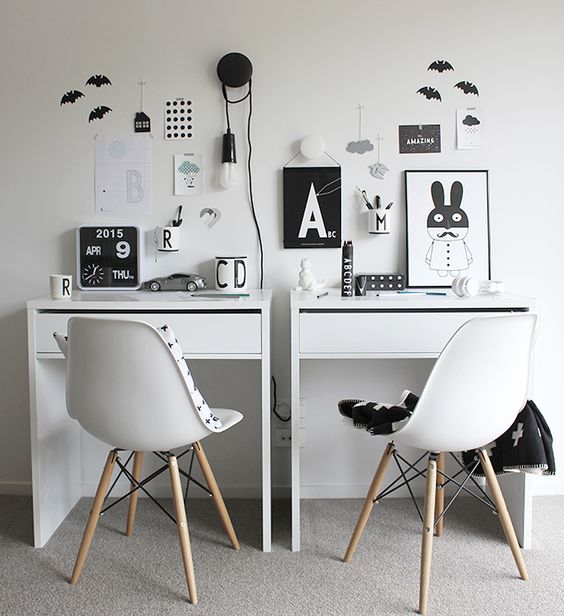 a double study space for kids done in Scandinavian style and in a laconic black and white color scheme