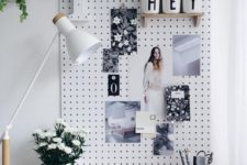 27 a pegboard is an ideal pinboard and you may attach shelves and other stuff to it