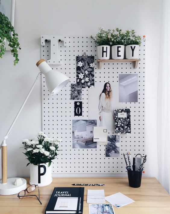 a pegboard is an ideal pinboard and you may attach shelves and other stuff to it