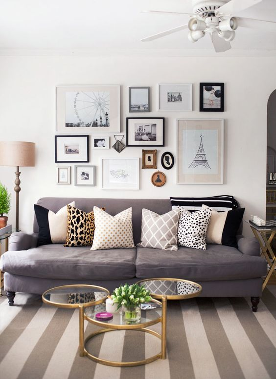 travel-inspired gallery wall with different frames and sizes of them
