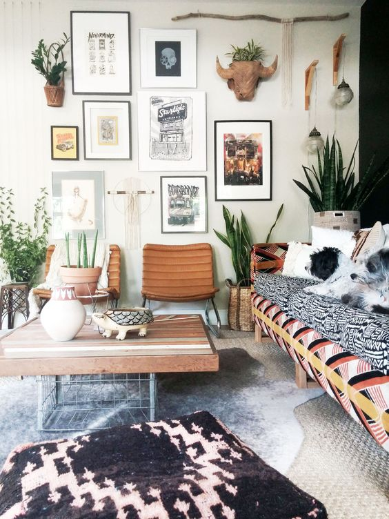 a boho living room with a cool gallery wall and boho-inspired art pieces