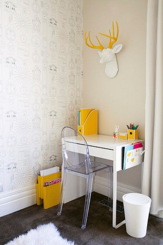a small and fun kid's workspace with a Micke desk, an acrylic chair and some bold yellow touches