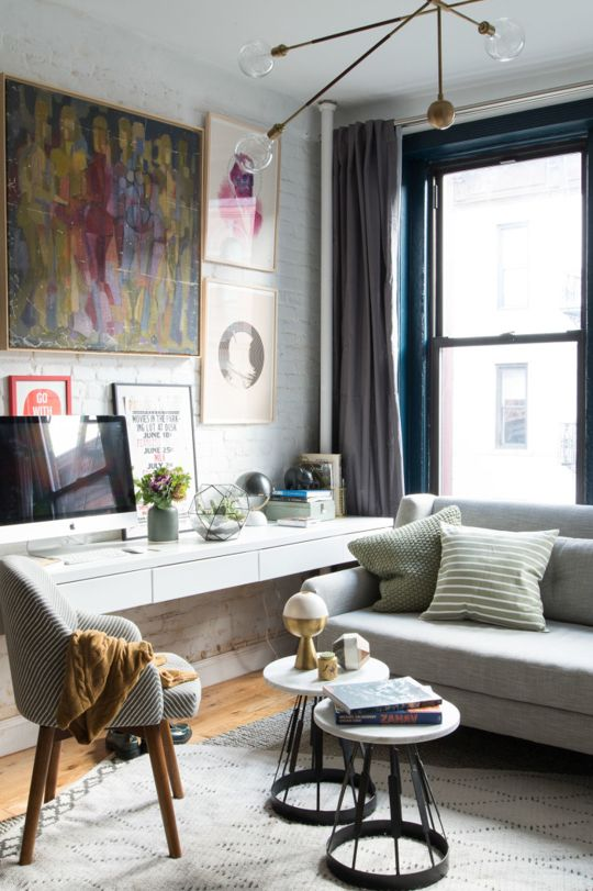 a white floating desk in the corner of the room doesn't require much space