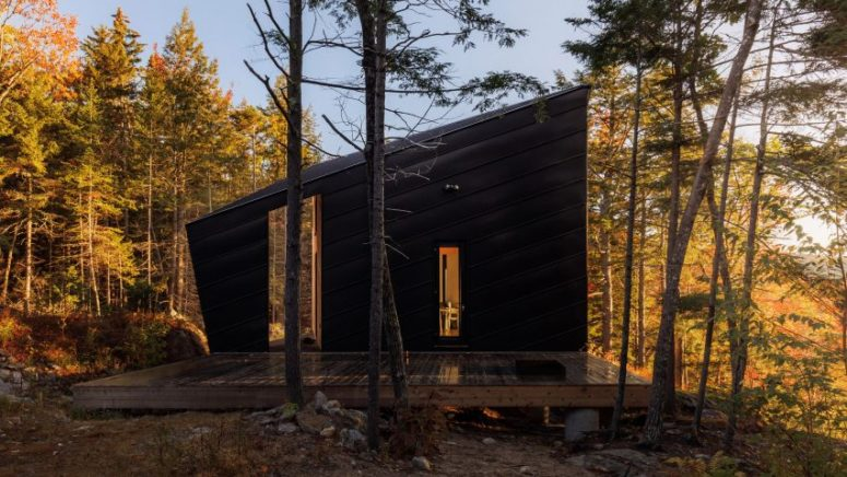 This angular forest cabin was designed as a weekend retreat for a couple with two kids