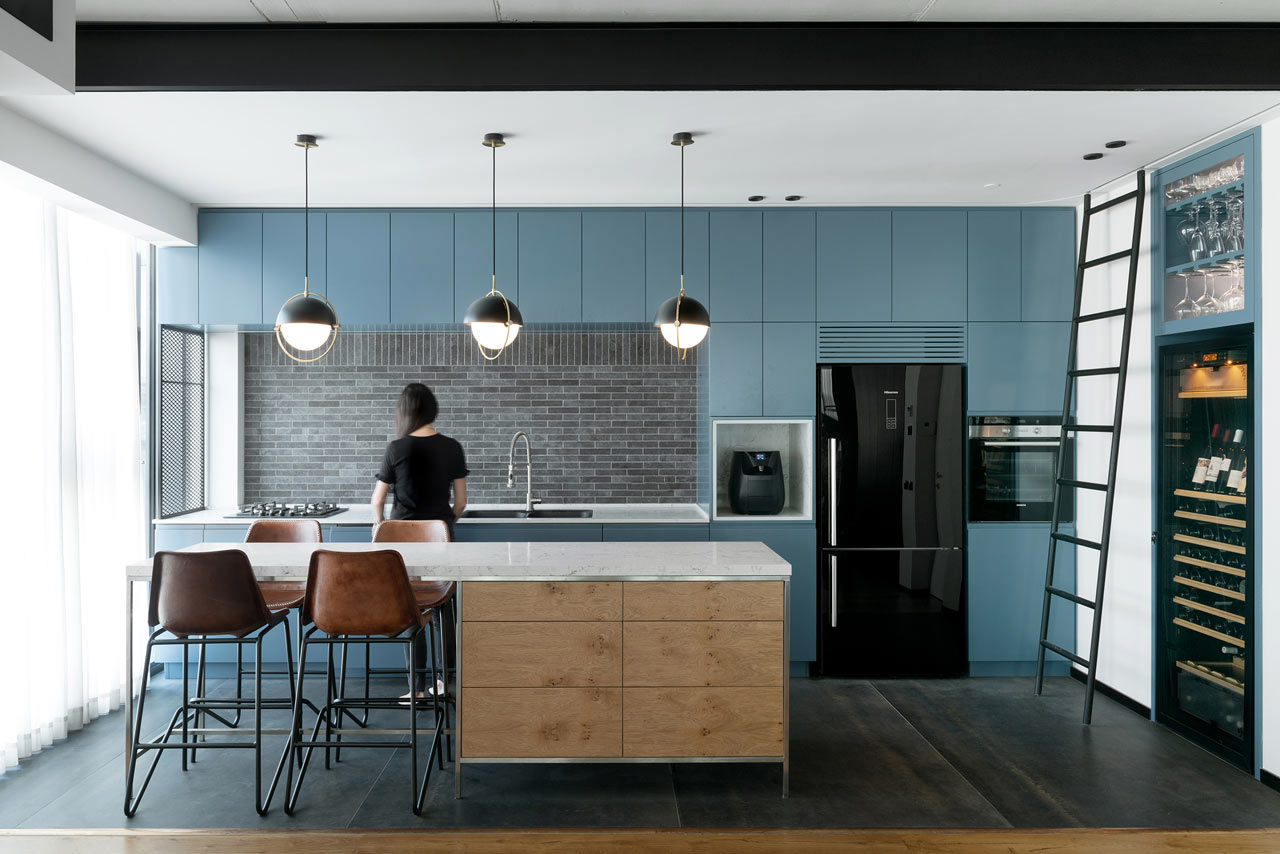 This contemporary apartment features an open layout, functional interiors and stylish touches of industrial aesthetics